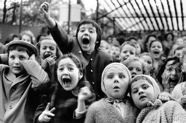 "Children Watching the Story of ""Saint George and the Dragon"" at the Puppet Theater in the Tuileries, Paris, 1963"