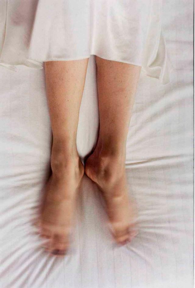 Elinor Carucci, Feet Moving on Bed, 1999 chromogenic print